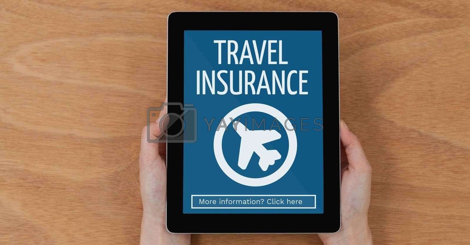 Person holding a tablet with travel insurance concept on screen by Wavebreakmedia