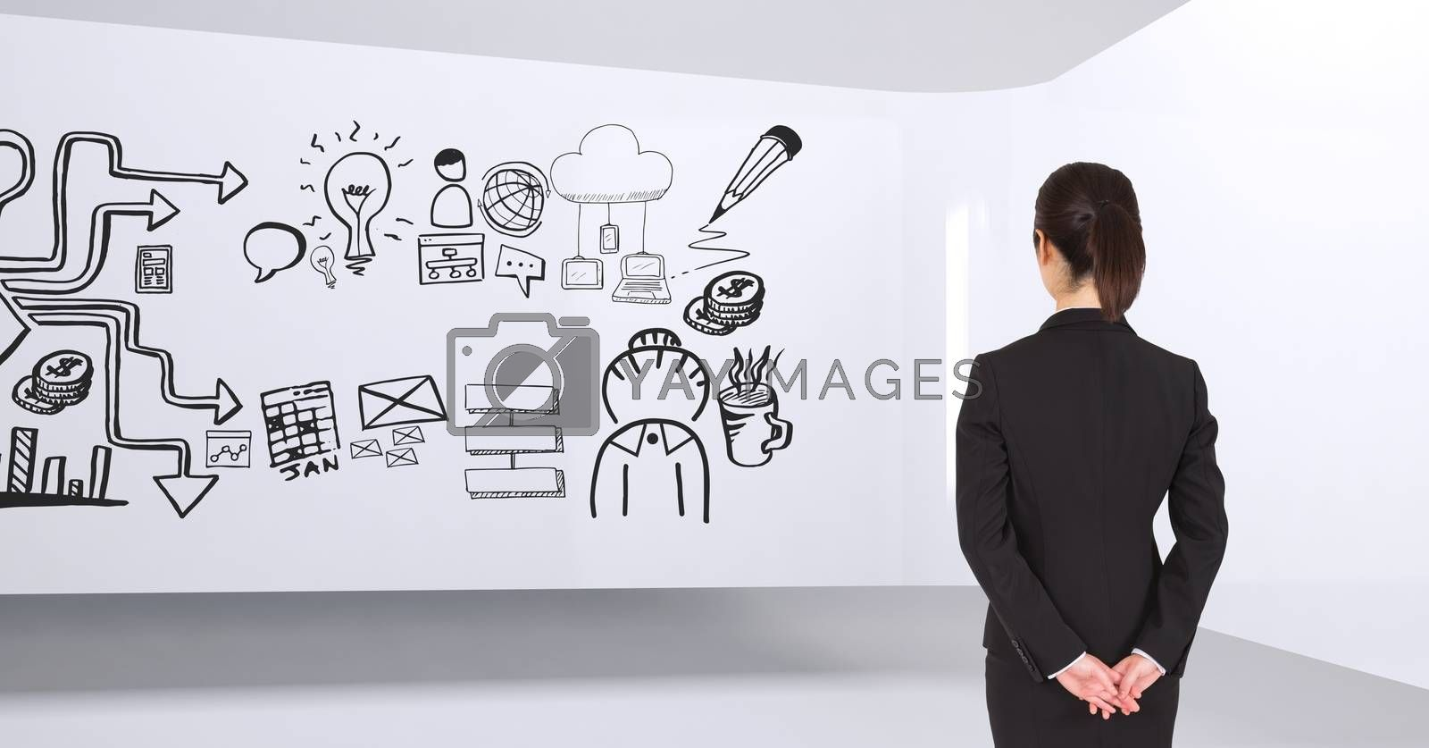 Business woman standing in a 3D room with a conceptual graphic on the wall by Wavebreakmedia