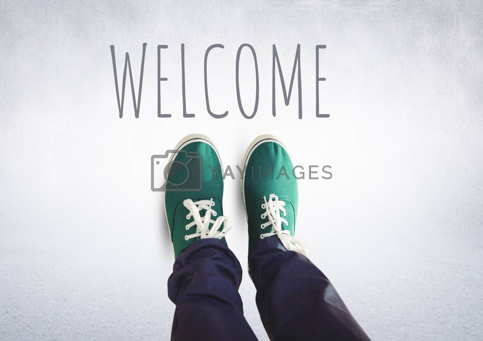 Welcome text and green shoes on feet with grey background by Wavebreakmedia