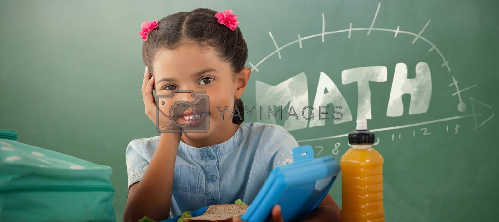 Composite image of smiling girl with lunch box at table by Wavebreakmedia