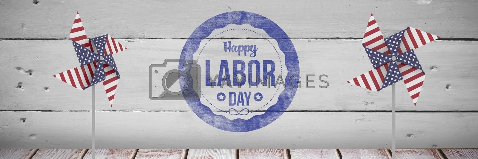 Happy labor day text and USA wind catchers in front of wood by Wavebreakmedia