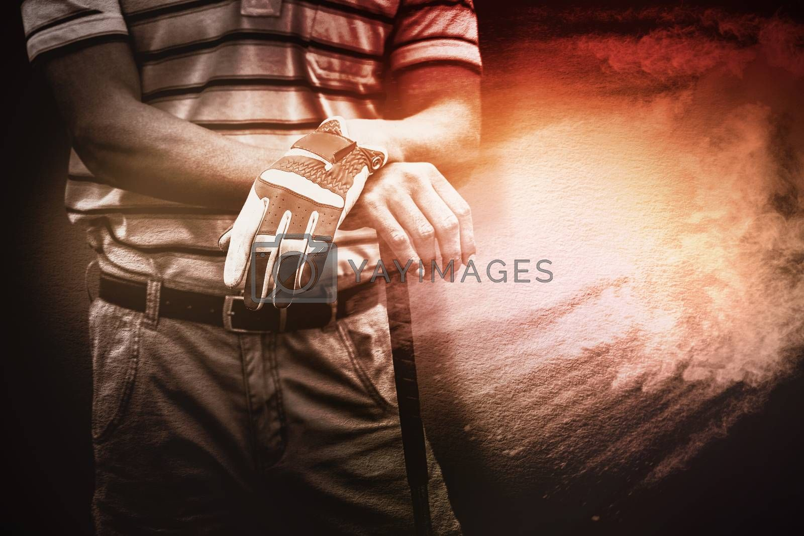 Composite image of man holding a golf club by Wavebreakmedia