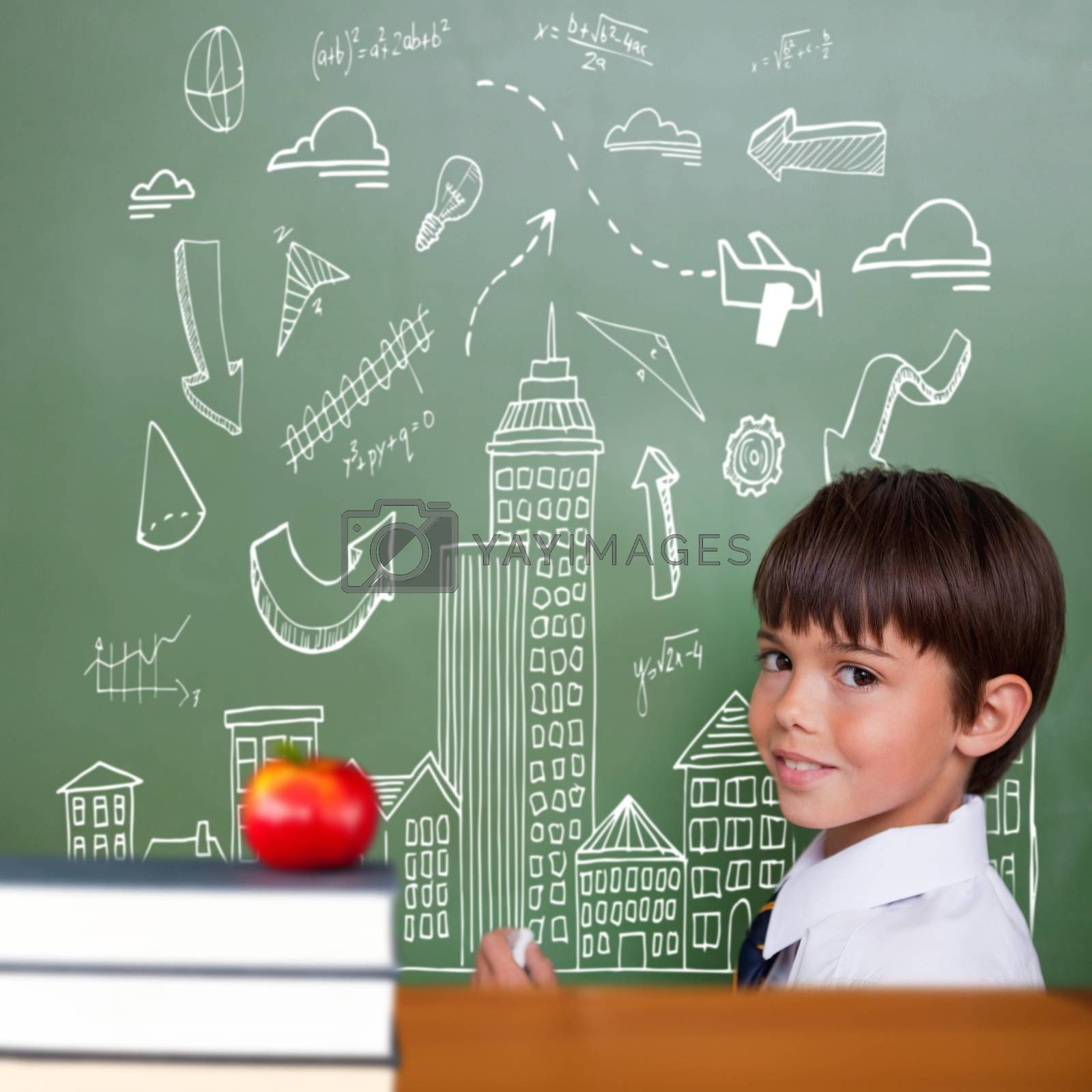 Red apple on pile of books against cute pupil holding chalk