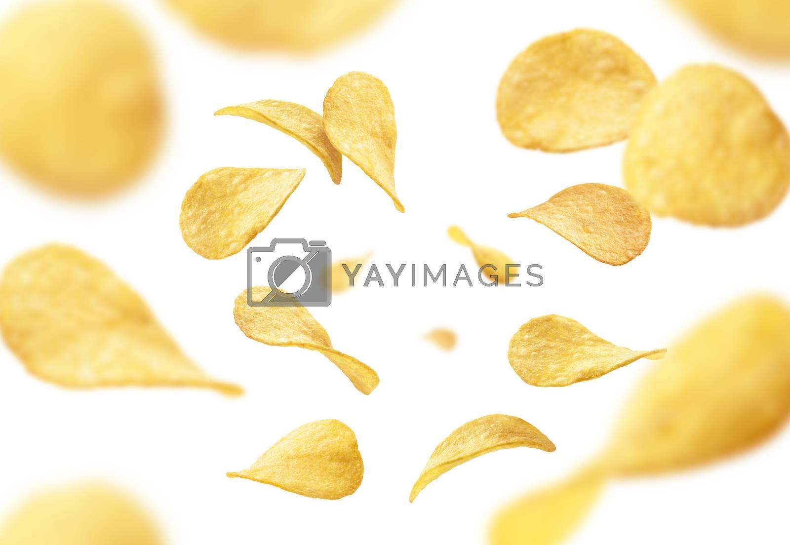 Potato chips levitate on a white background.