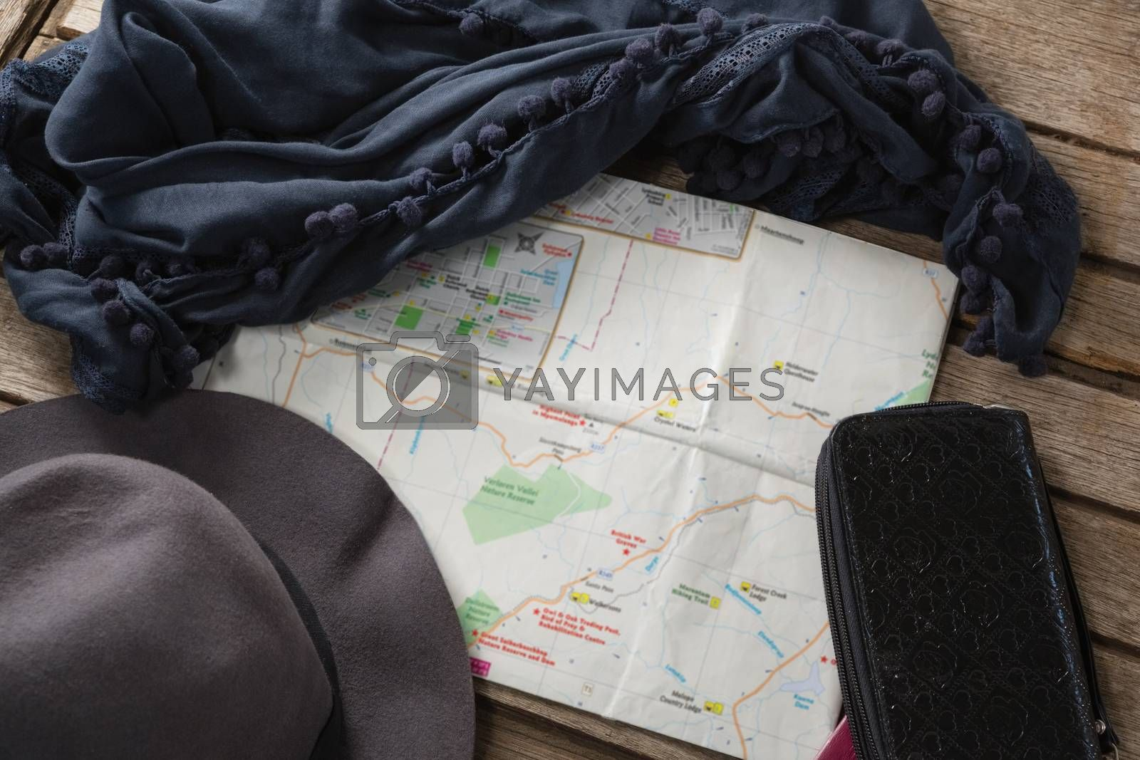 Travel accessories on wooden table by Wavebreakmedia