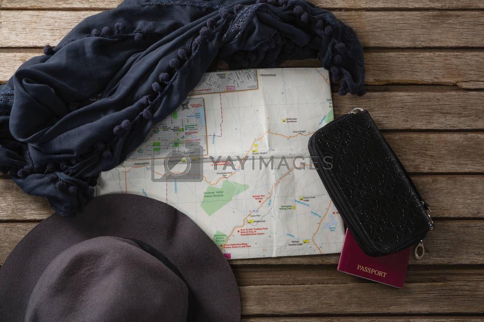 Overhead of travel accessories on wooden table