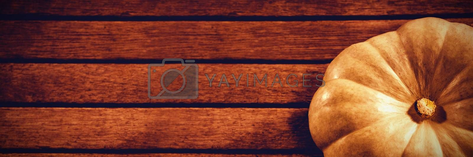 High angle view of white pumpkin on wooden table during Halloween