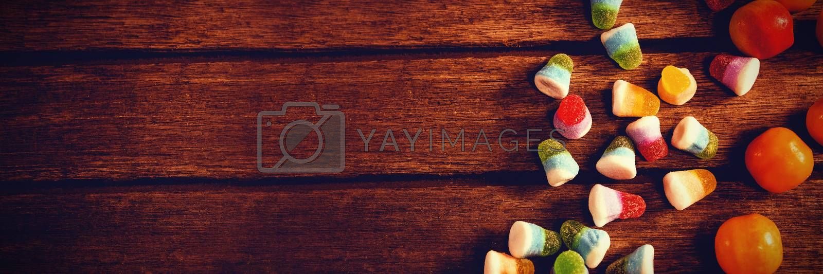 Overhead view of colorful sweet food on wooden table