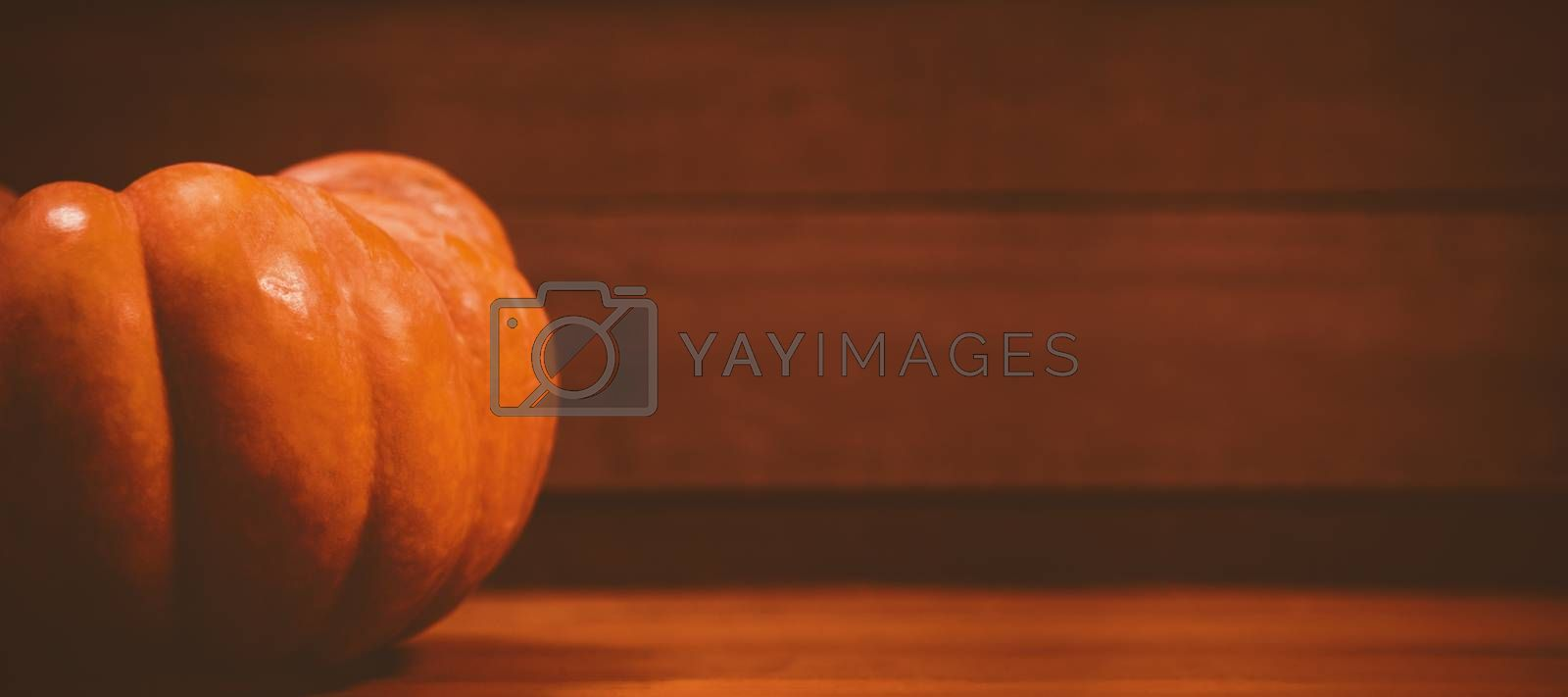 Pumpkin on wooden table during Halloween