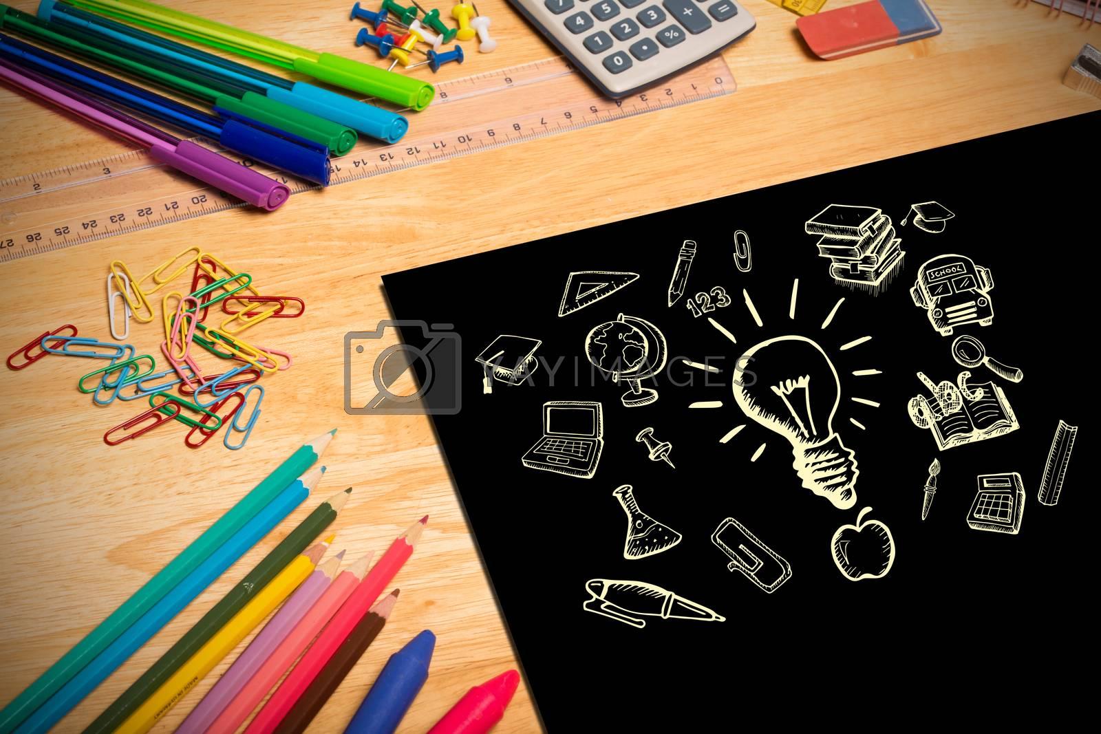 Composite image of education doodles against students desk