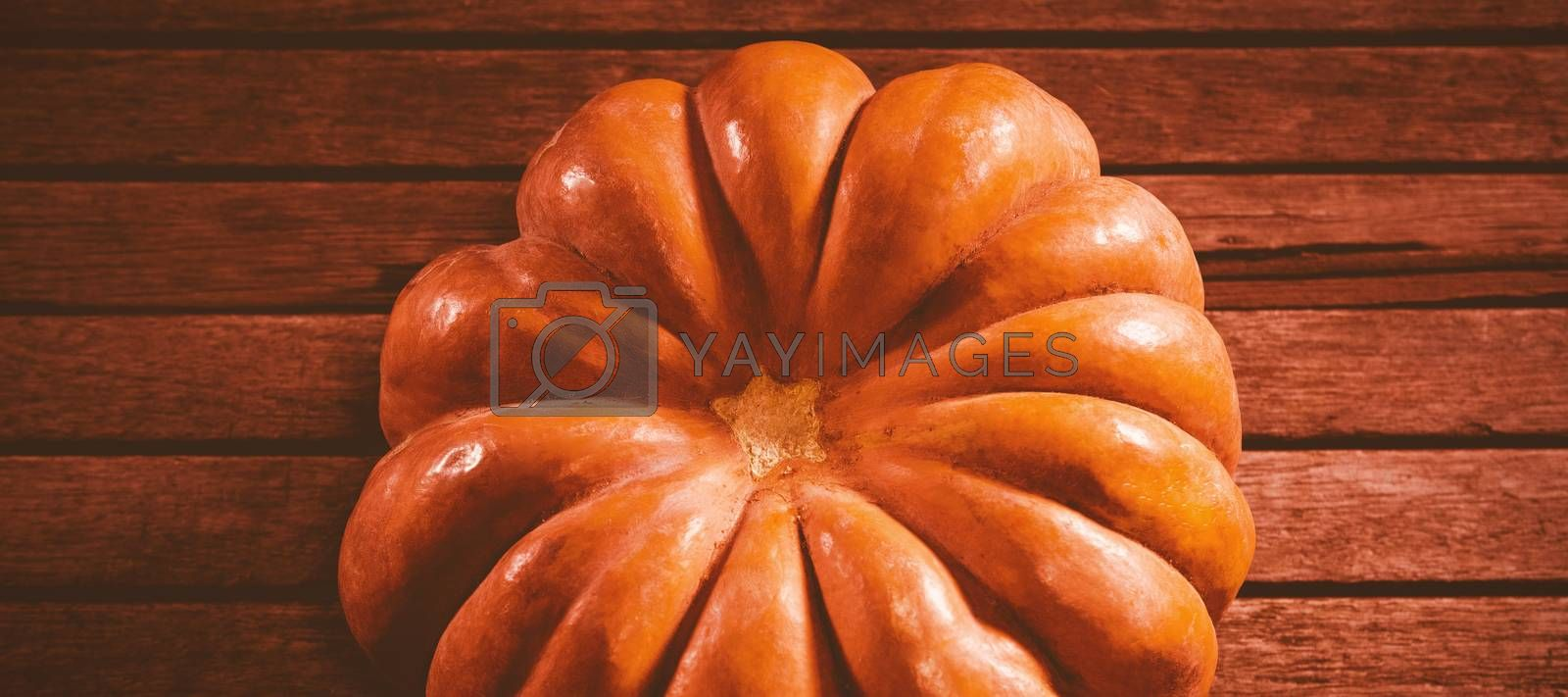 High angle view of pumpkin on wooden table during Halloween