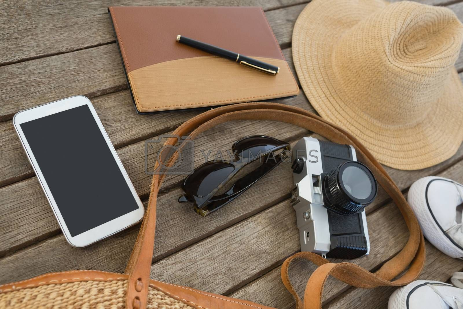 Travel accessories on wooden plank by Wavebreakmedia