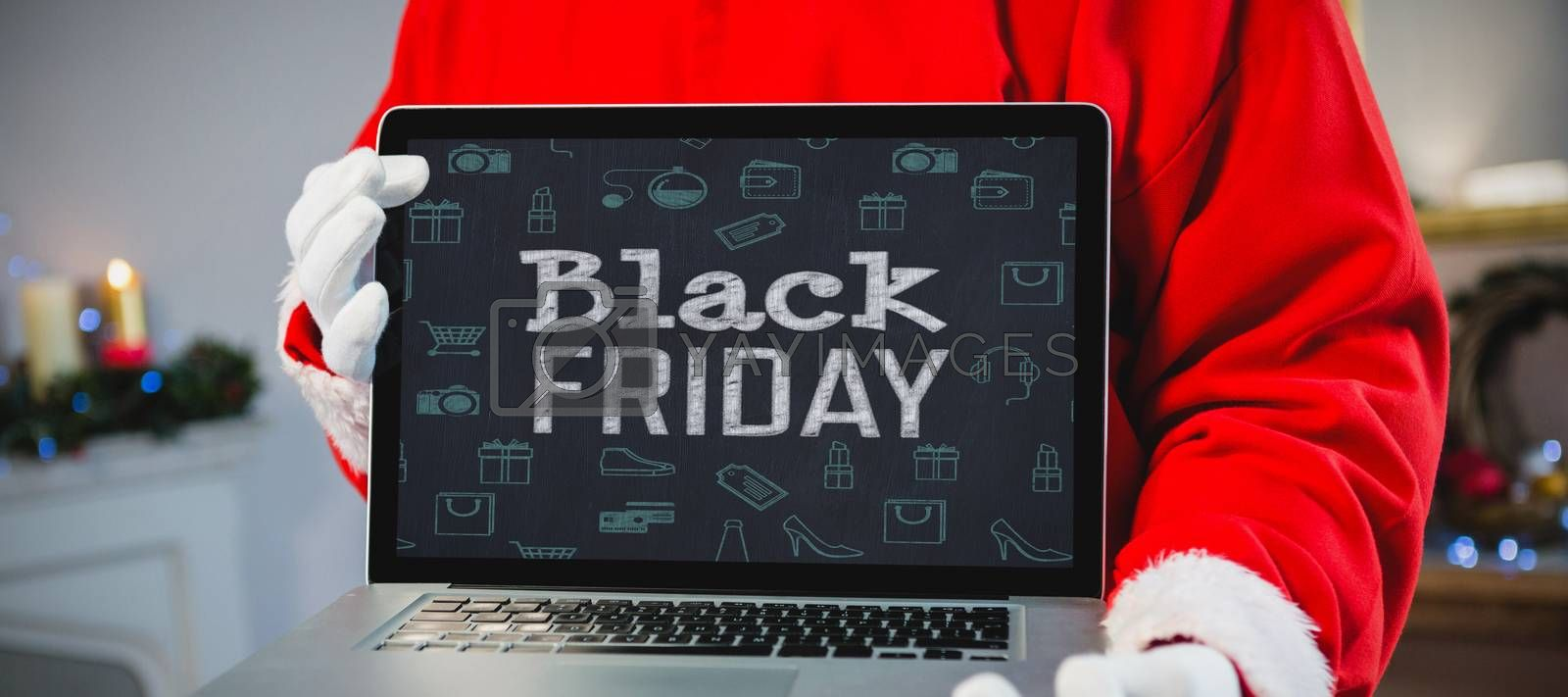 Black friday advert against santa claus holding a laptop