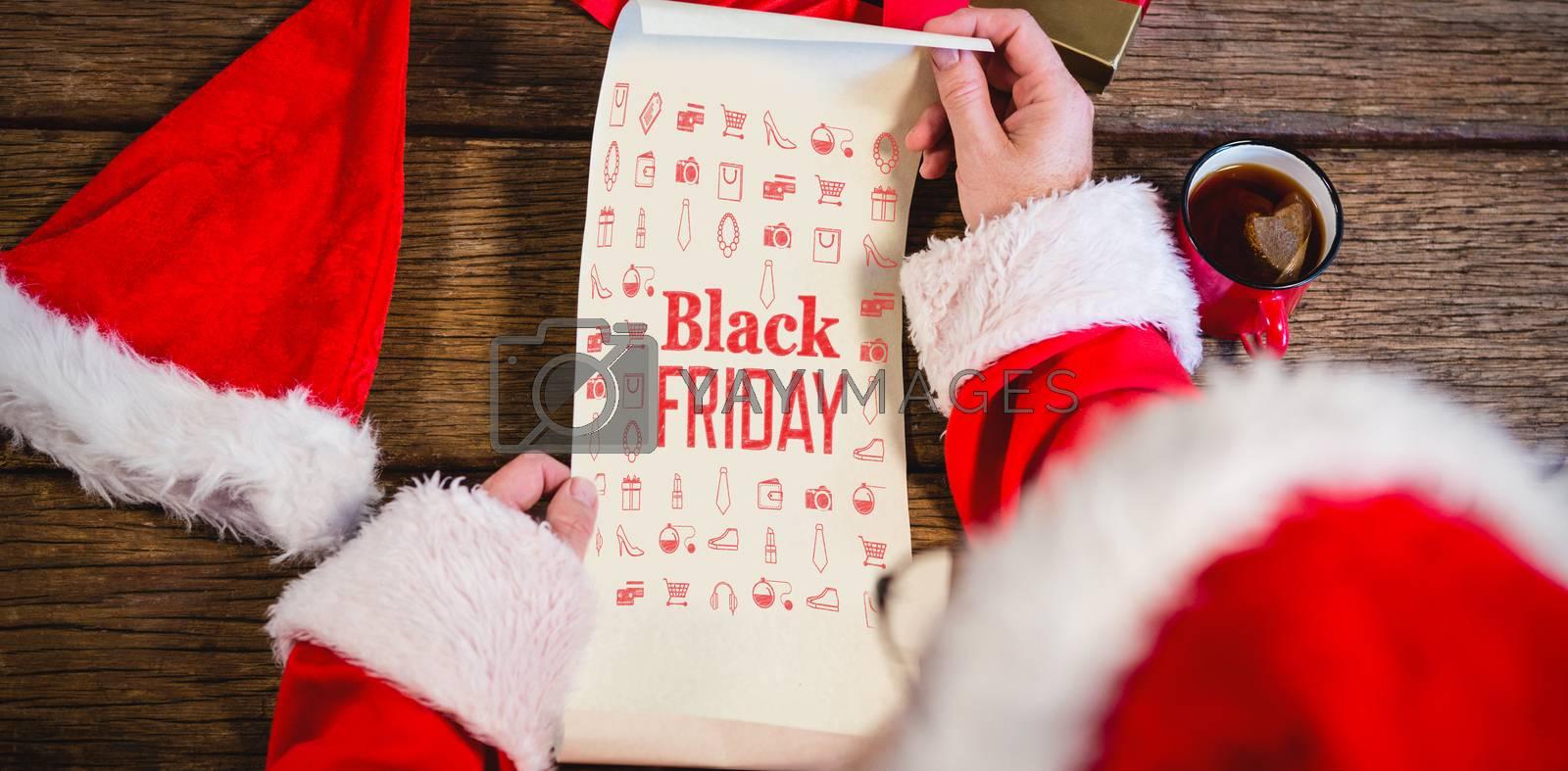 Black friday advert against santa claus reading scroll