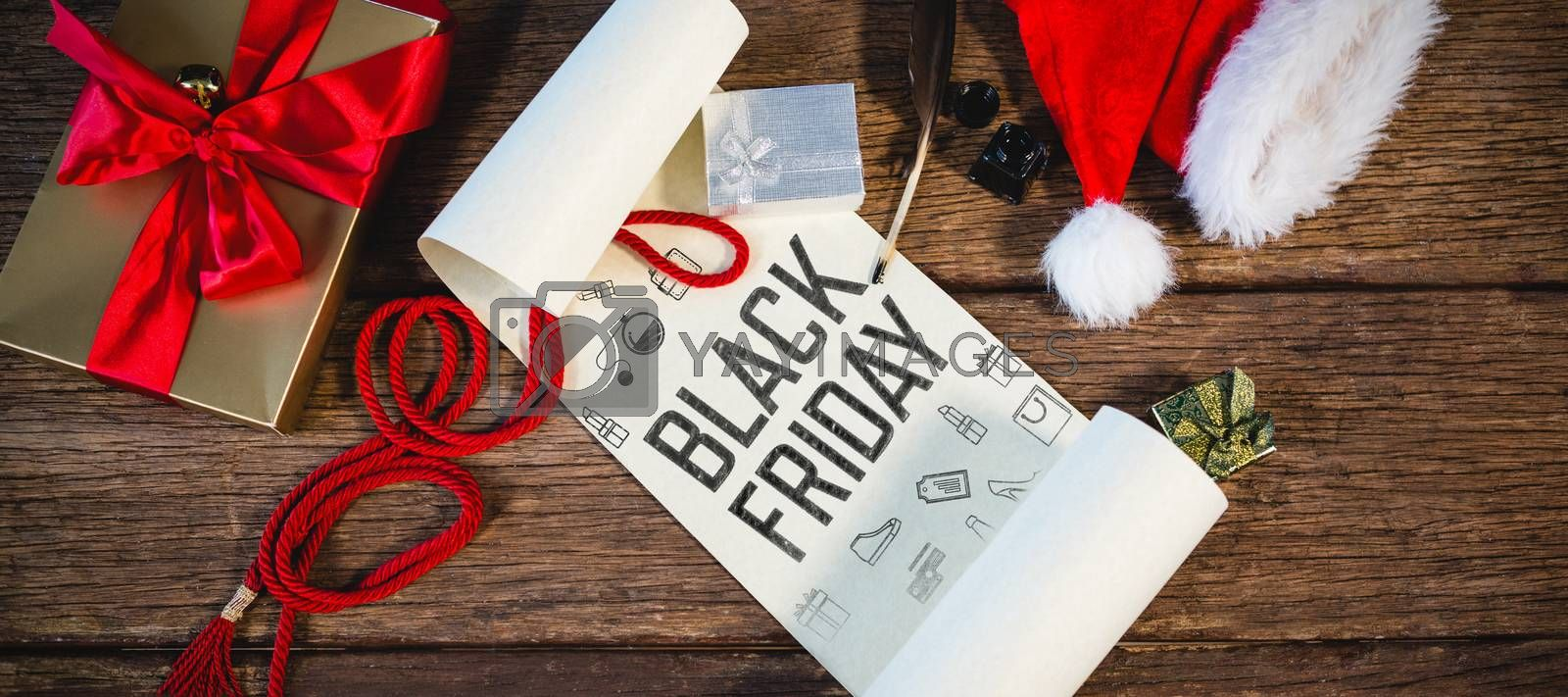 Black friday advert against wrapped gift, santa hat, diary and quill pen on wooden table in living room
