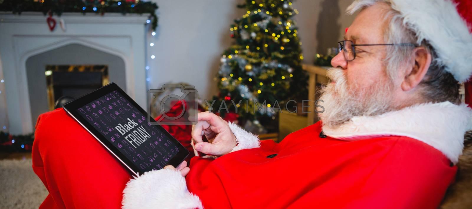 Black friday advert against santa claus using digital tablet