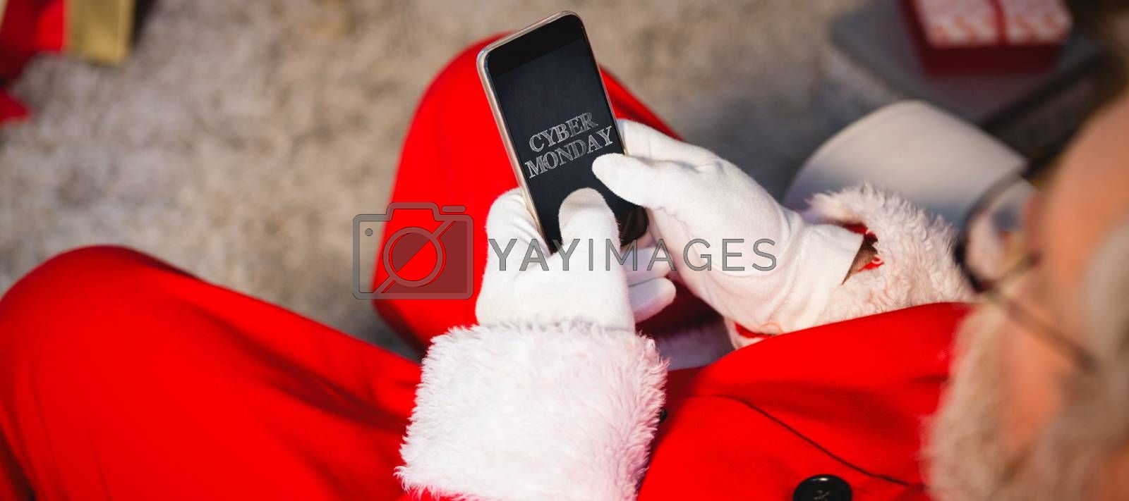 Title for celebration of cyber Monday  against santa claus using mobile phone at home