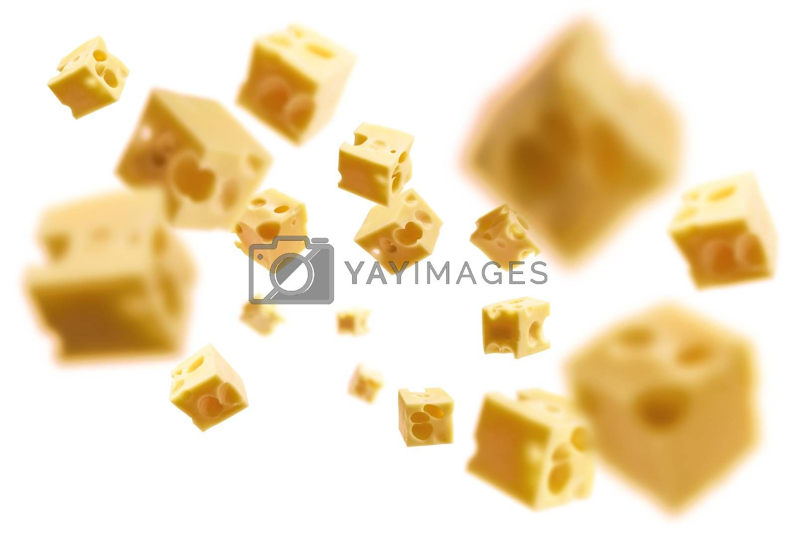 Cheese cubes levitate on a white background.