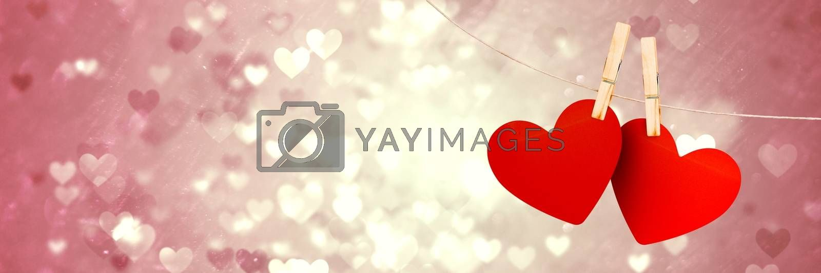 Digital composite of Valentines hanging love hearts and love hearts background