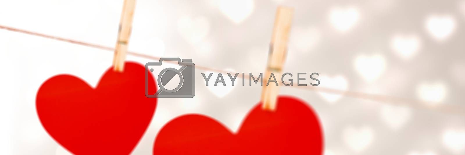 Digital composite of Valentines hanging love hearts