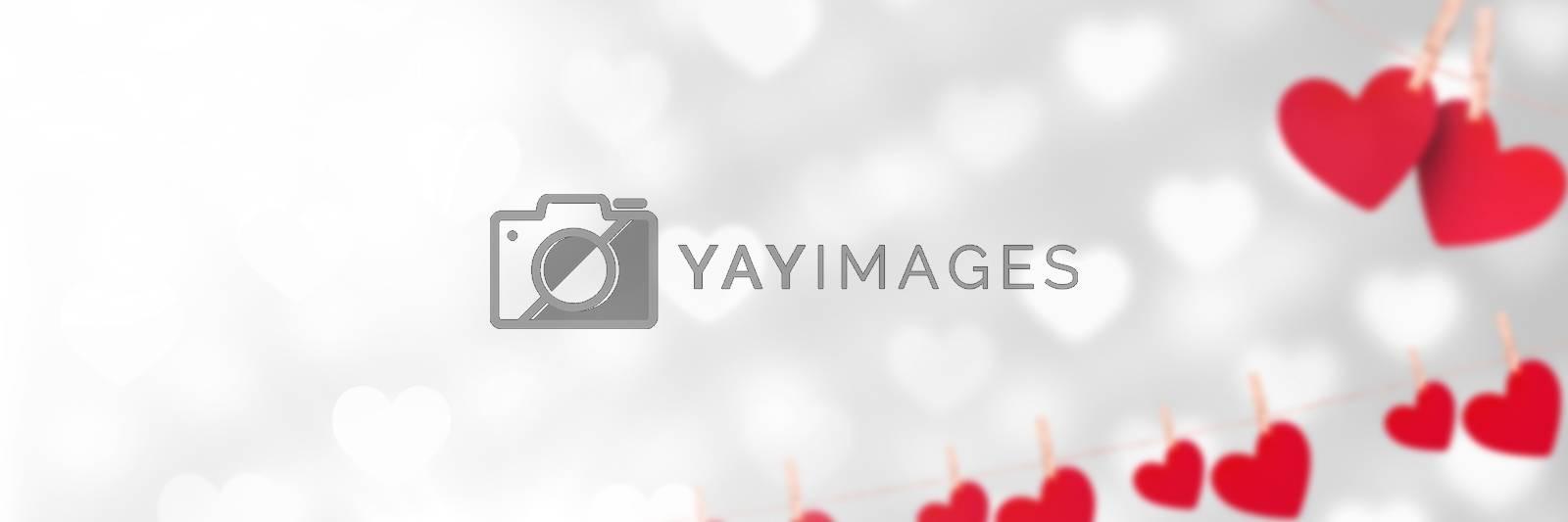 Digital composite of Valentines hanging love hearts background