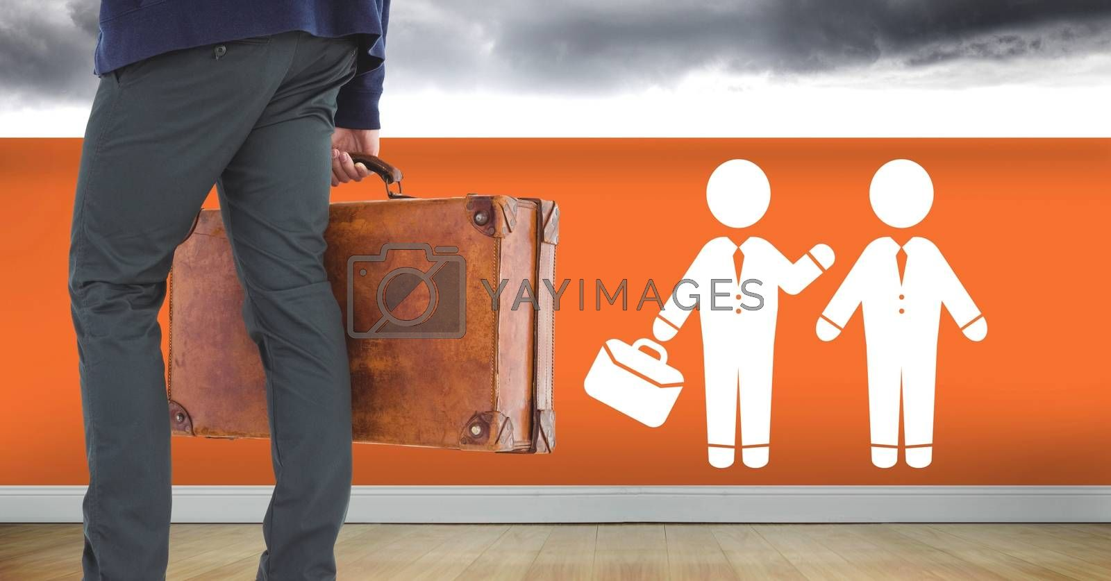 Digital composite of Businessman with briefcase and people meeting icon on wall