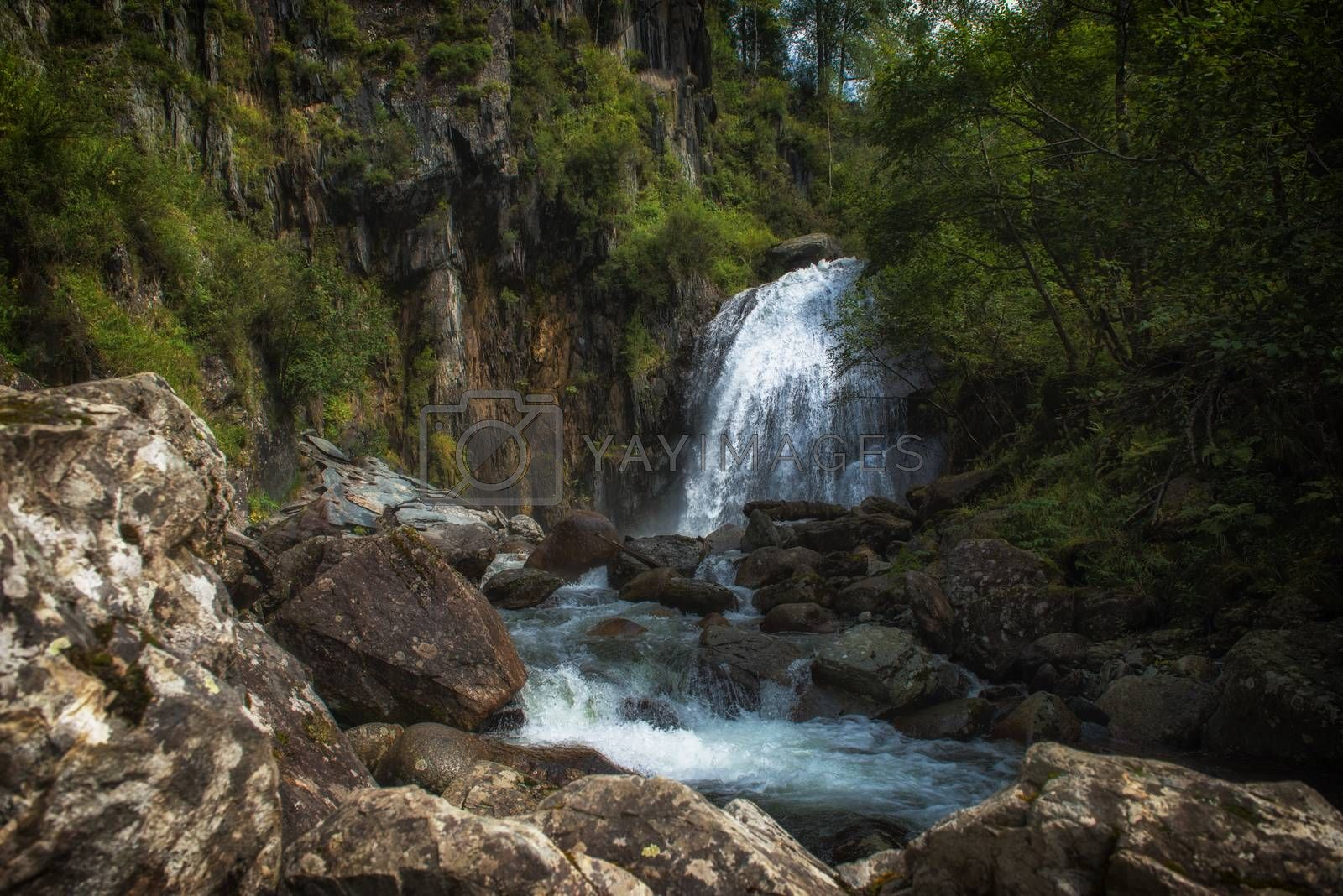 Korbu Waterfall at Lake Teletskoye in the Altai Mountains. The most famous lake waterfall