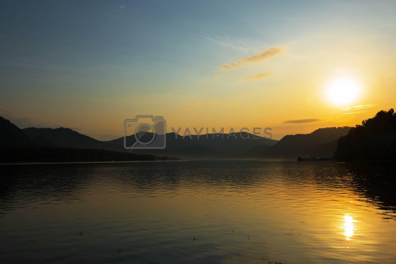 Sunset on Teletskoye lake in Altai mountains, Siberia, Russia. Drone shot.