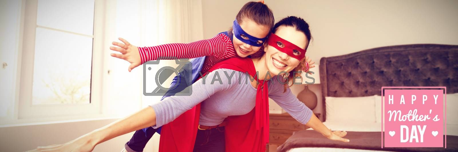 mothers day greeting against mother and daughter playing superwoman