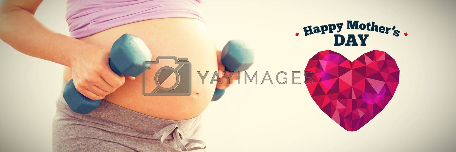 Pregnant woman holding dumbbells  against happy mothers day
