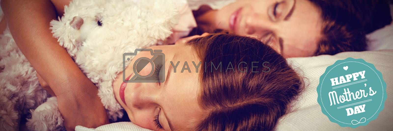 mothers day greeting against high angle view of family sleeping on bed