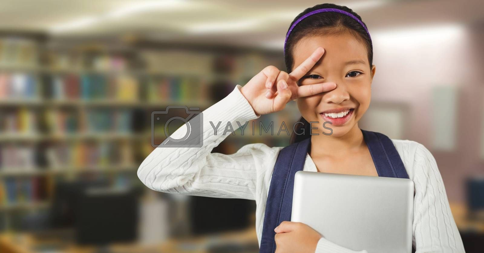 Girl in education library by Wavebreakmedia