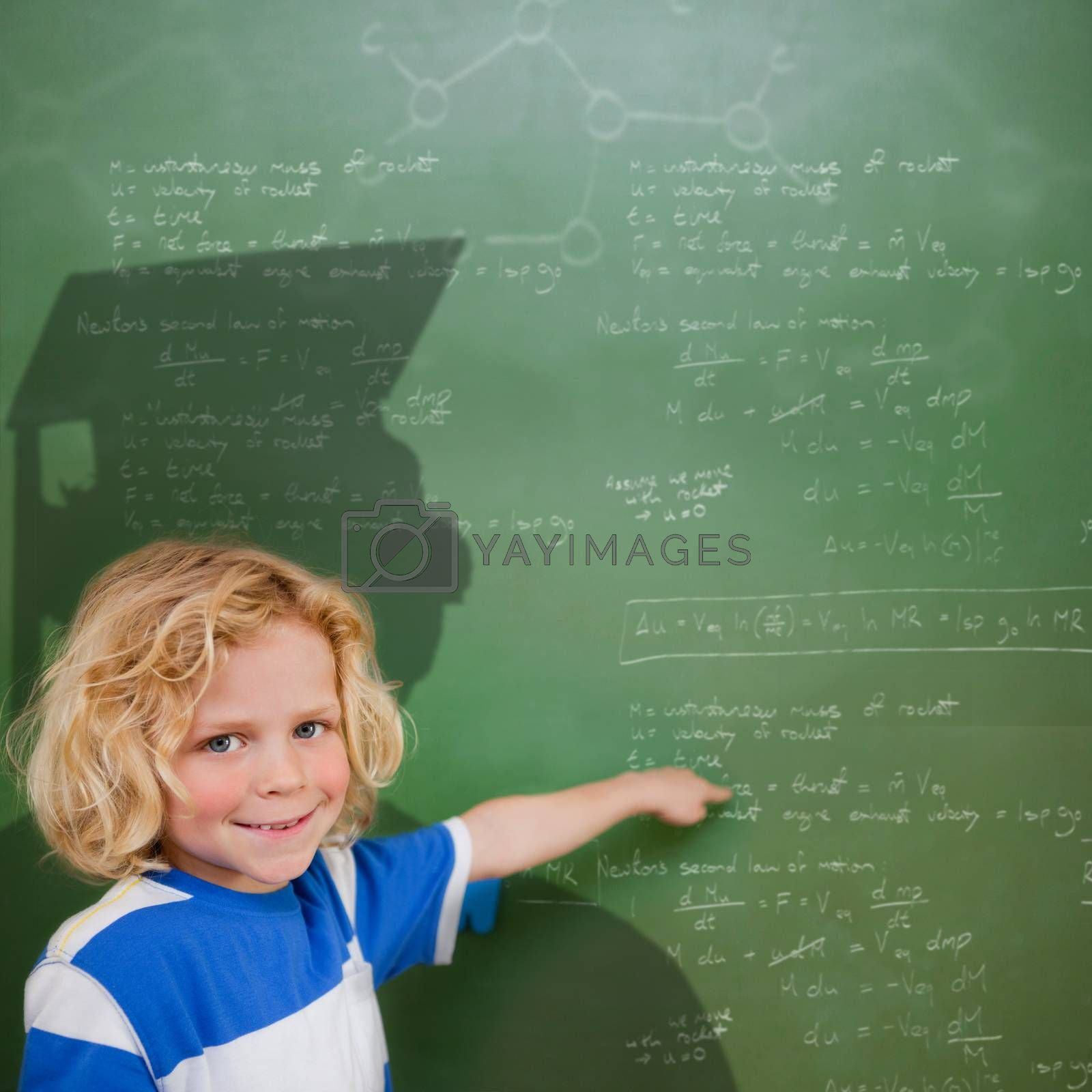 Composite image of cute pupil with graduate shadow in classroom