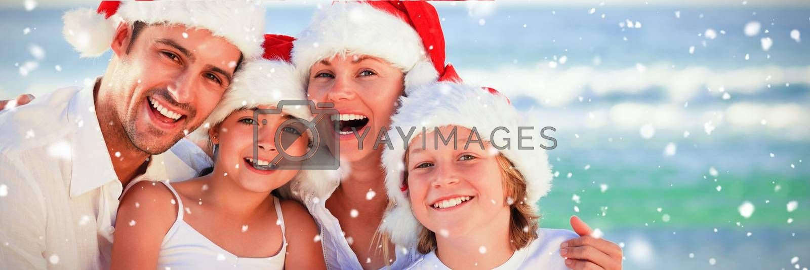Family during Christmas day at the beach against snow falling