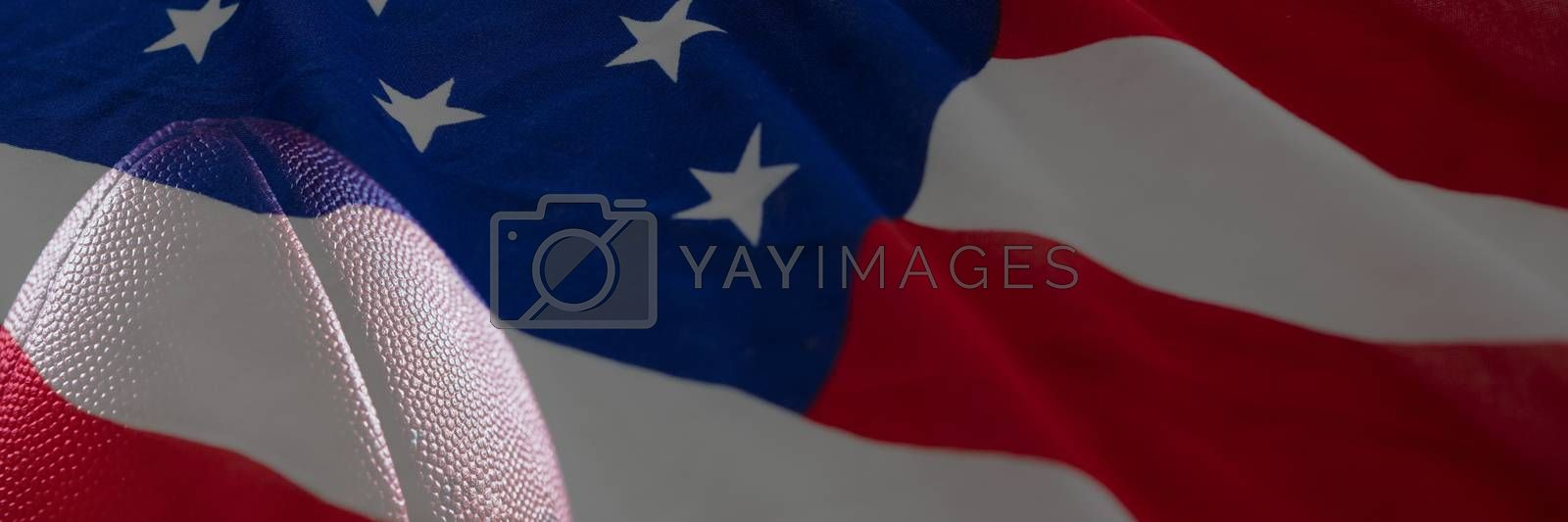 American flag with stars and stripes against rugby ball
