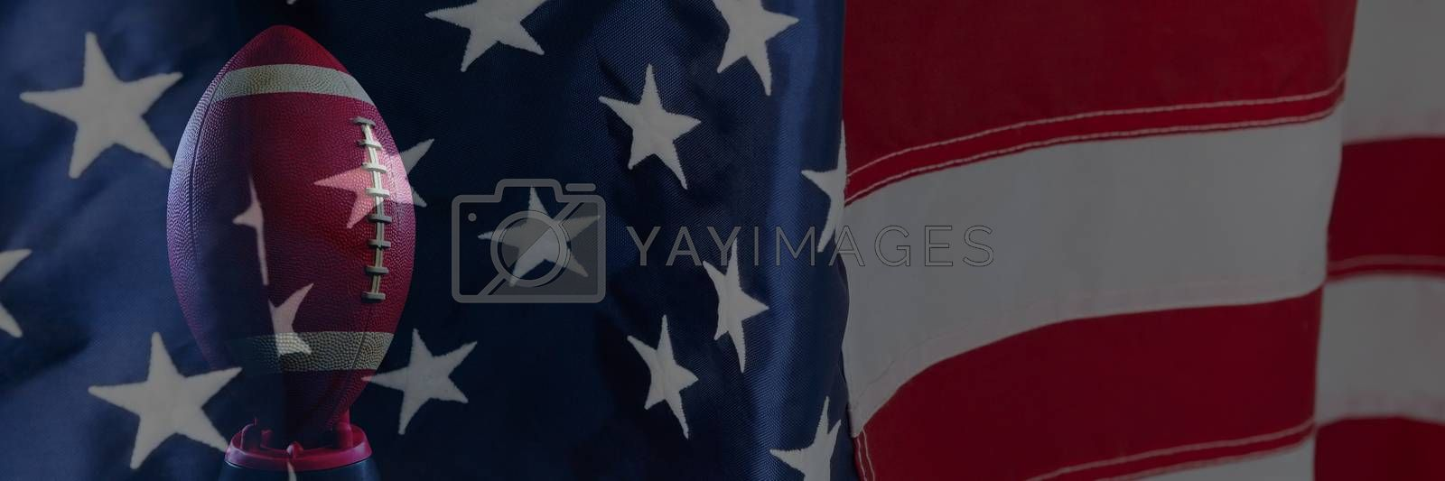 Close-up of an American flag against rugby ball