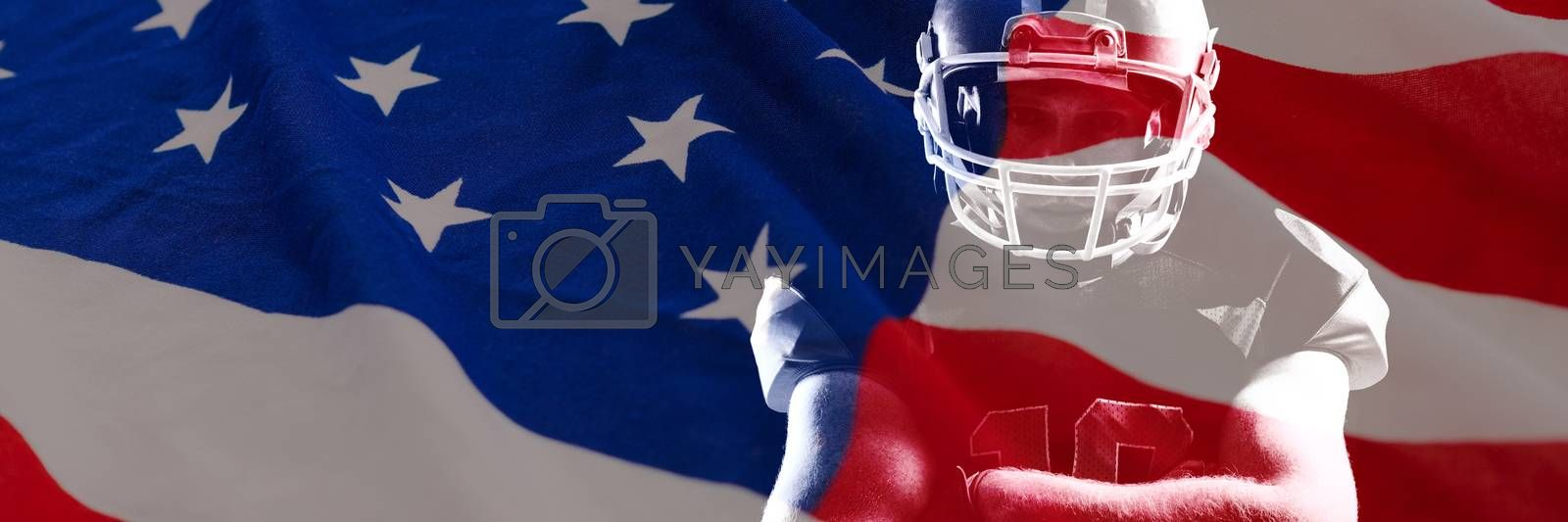 American flag with stars and stripes against american football player in helmet standing with arms crossed
