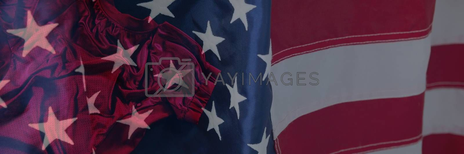 Close-up of an American flag against rugby jersey against black background