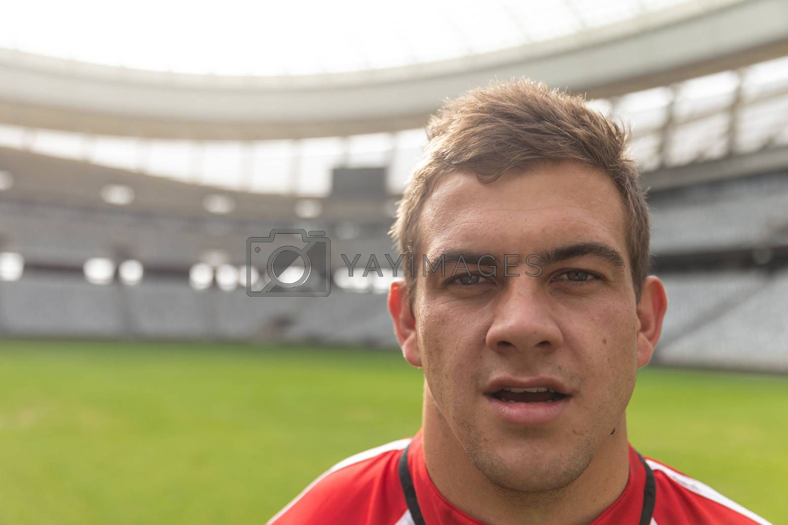 Portrait close up of handsome Caucasian rugby player looking at camera in the stadium.