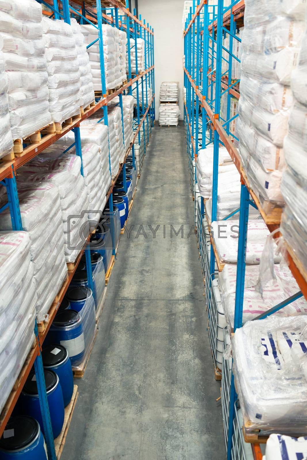 High angle view of barrel and goods arranged on a rack in warehouse. This is a freight transportation and distribution warehouse. Industrial and industrial workers concept