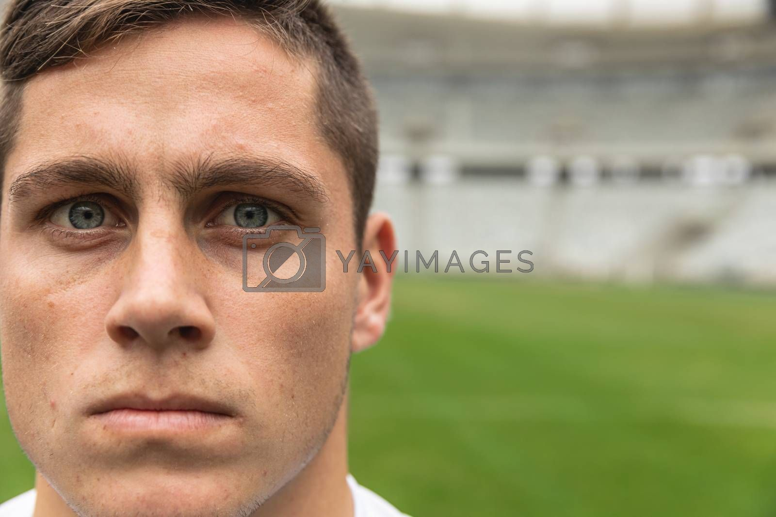 Close-up of Caucasian rugby player looking at camera in the stadium