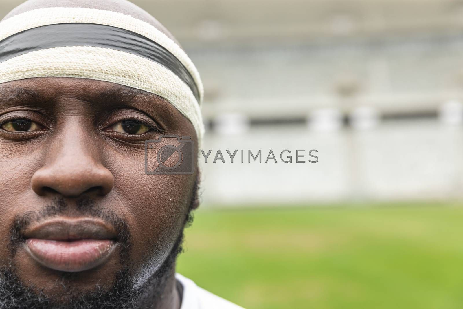 Close-up of African American rugby player looking at camera in the stadium