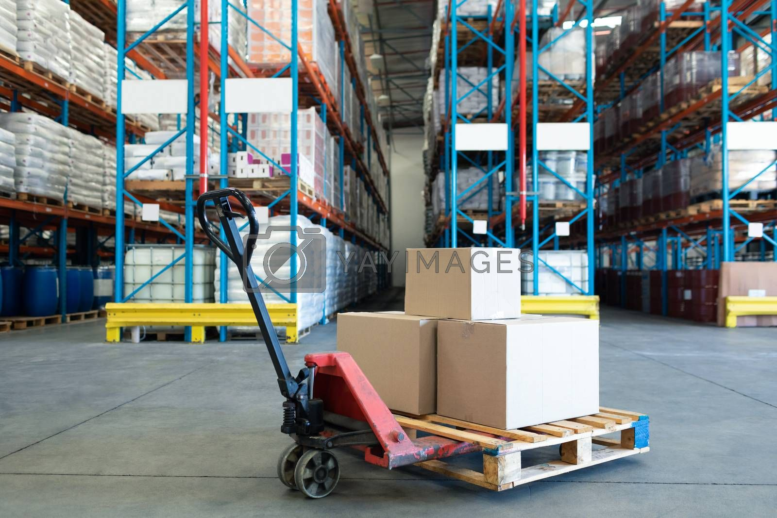 Cardboard boxes arranged on a pallet jack in warehouse. This is a freight transportation and distribution warehouse. Industrial and industrial workers concept