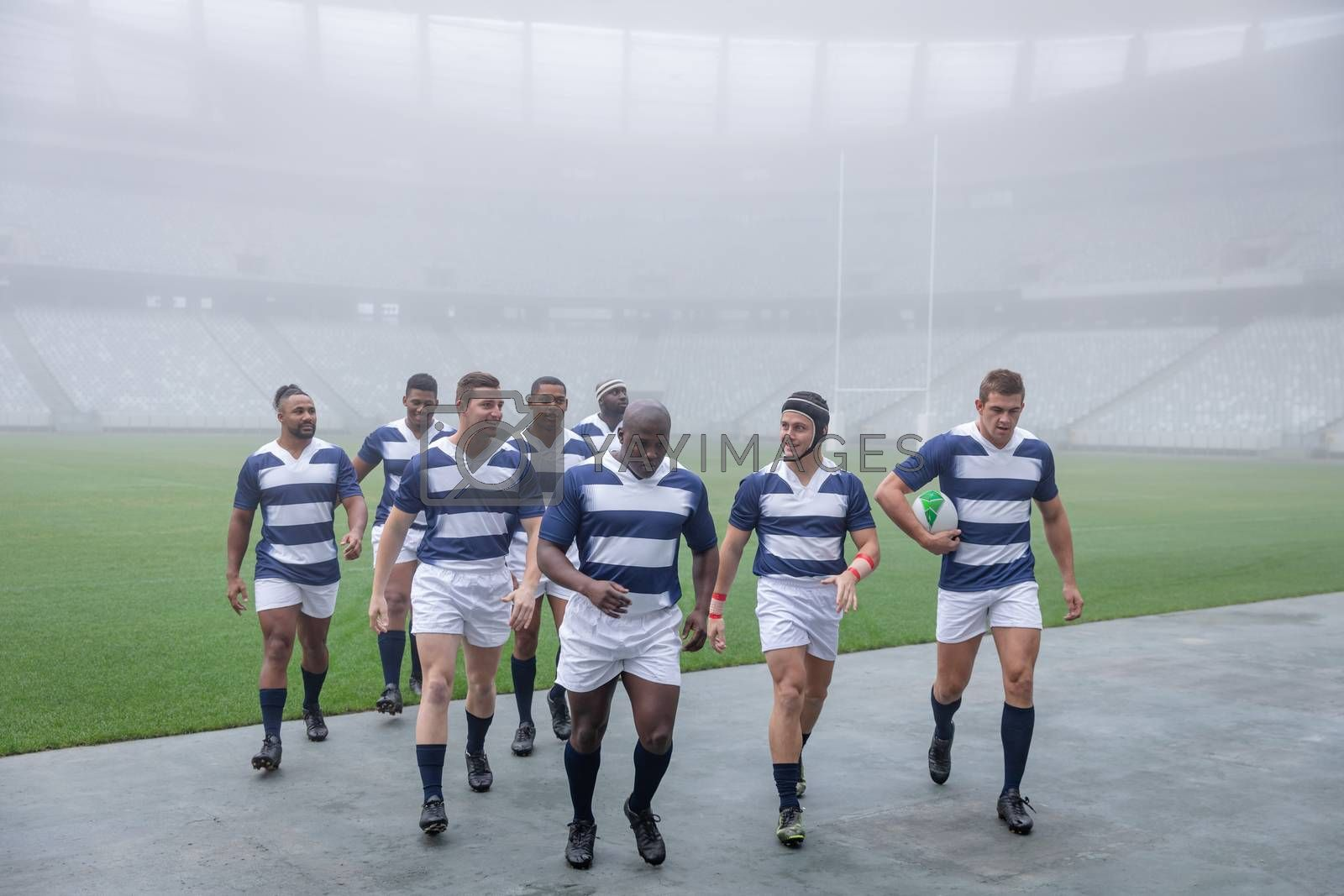 Front view of group of male rugby player walking together after match in stadium
