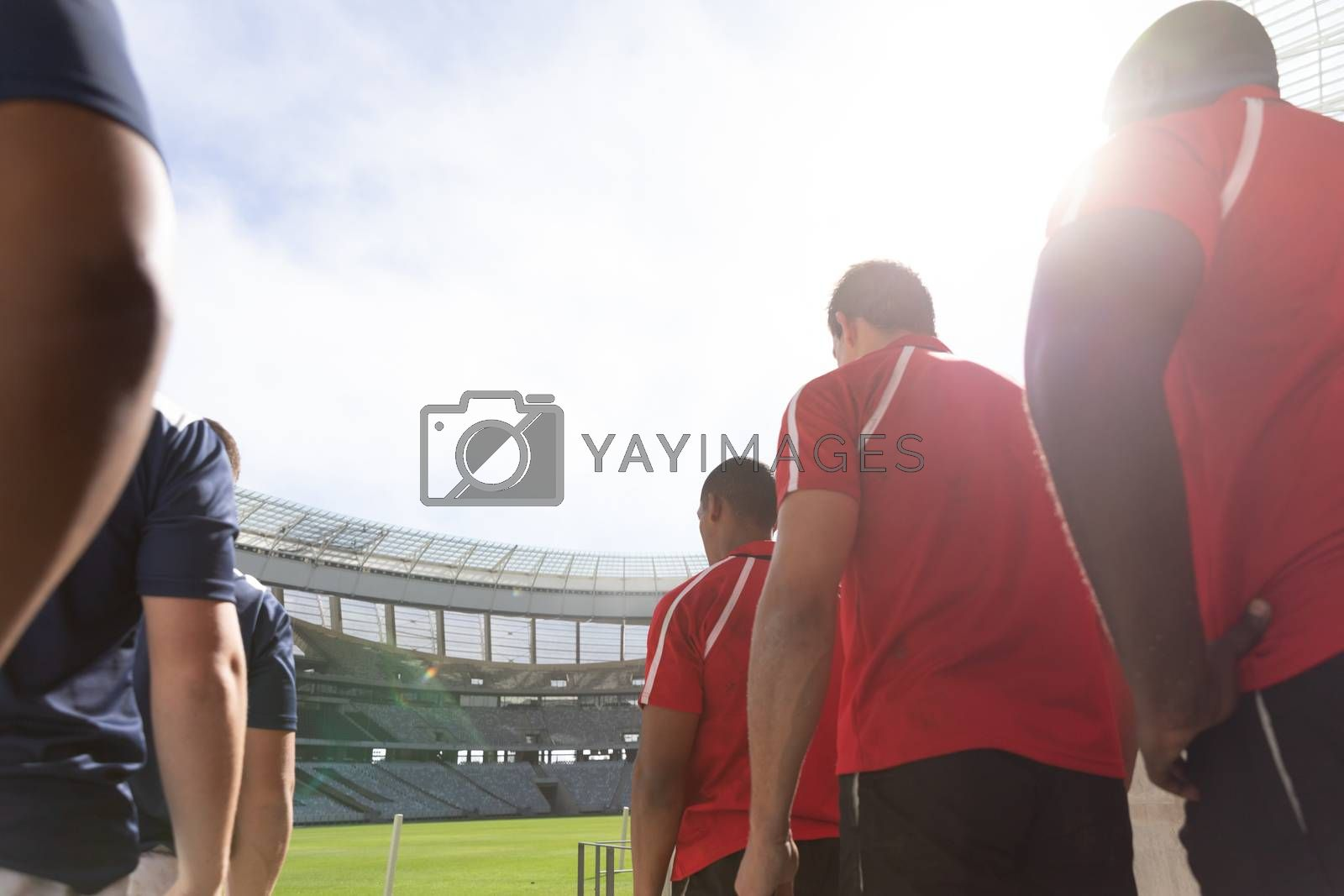 Low angle view of male rugby players standing in a row at stadium for match