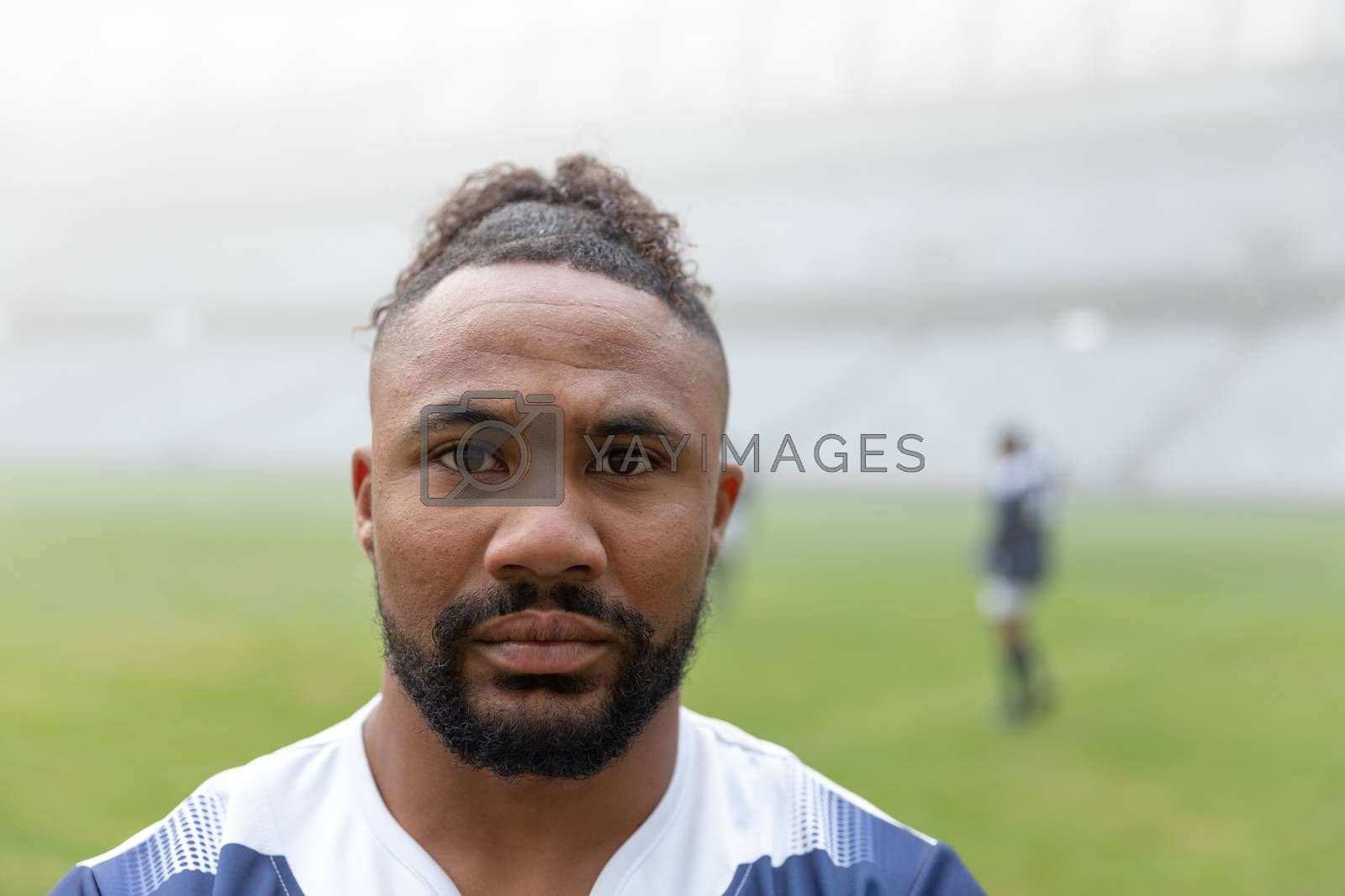 Portrait of  African american rugby player looking at camera in the stadium