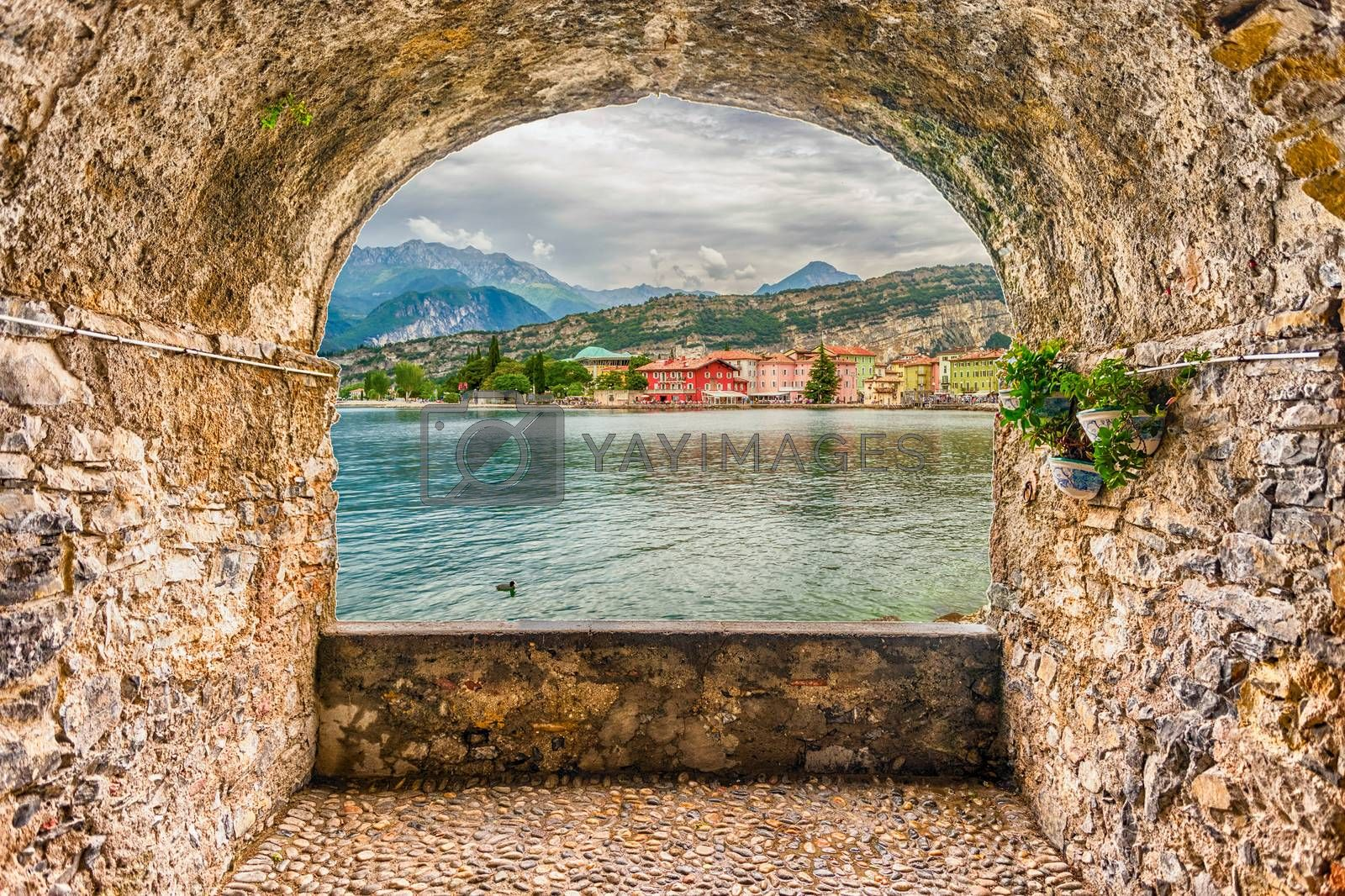 Scenic rock arch balcony overlooking the village of Torbole, lakeside, Lake Garda, Italy
