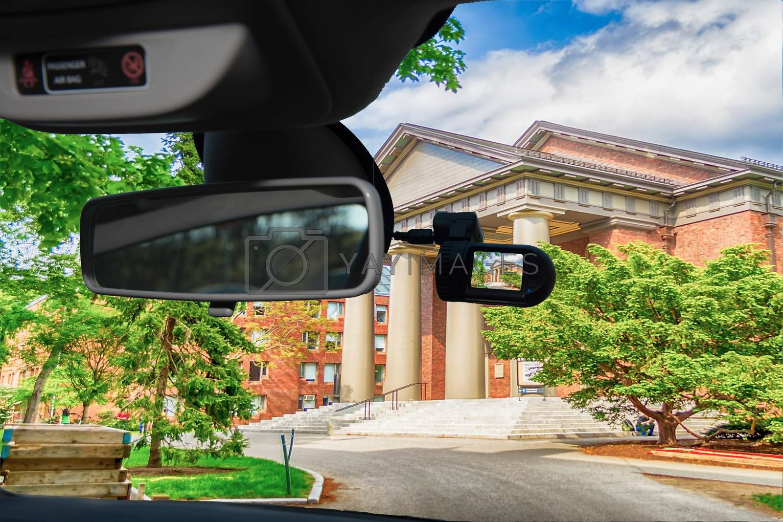 Looking through a dashcam car camera installed on a windshield with view of the Harvard University Campus, Cambridge, USA