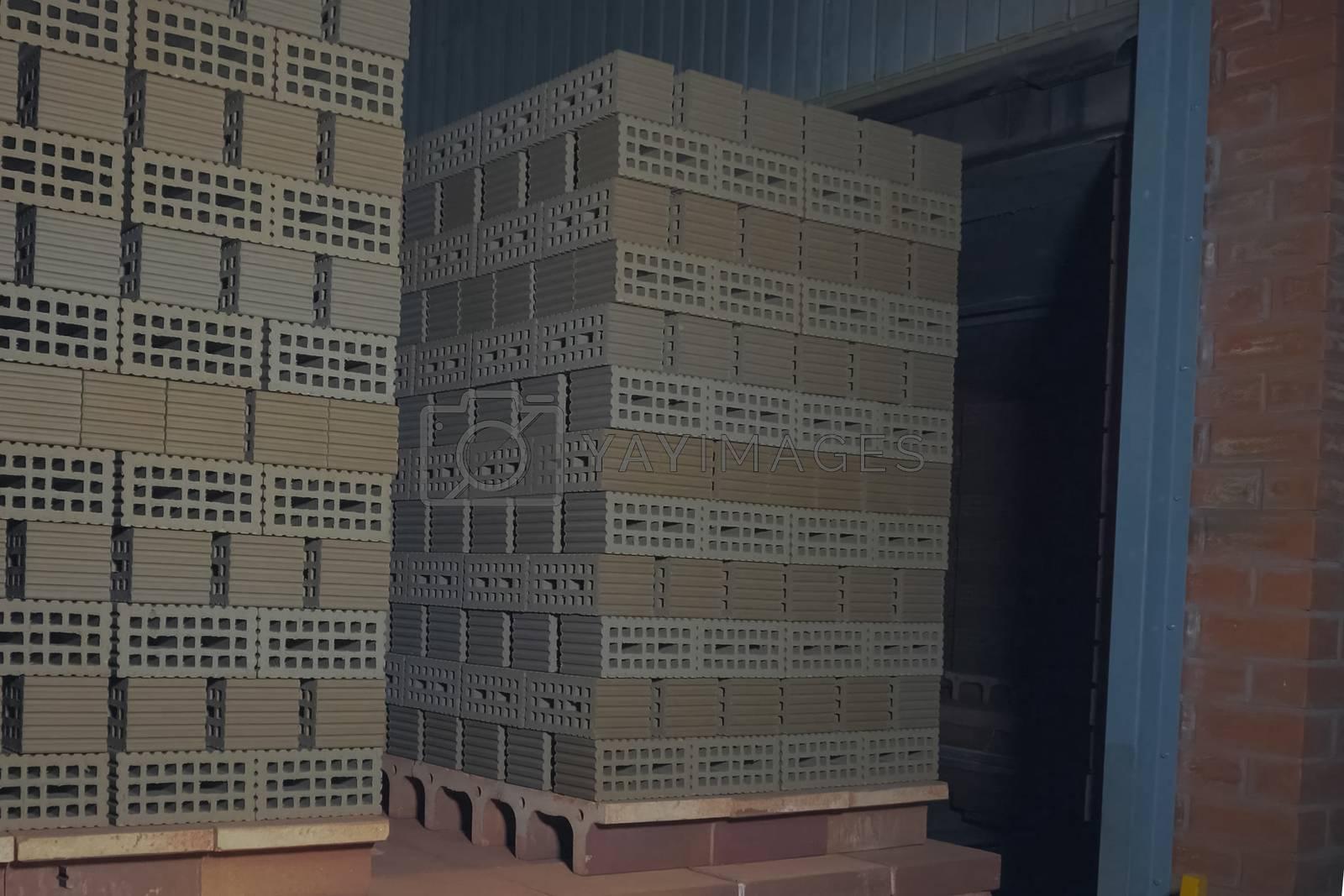 Transporting raw bricks to the roasting stove. Brickworks.