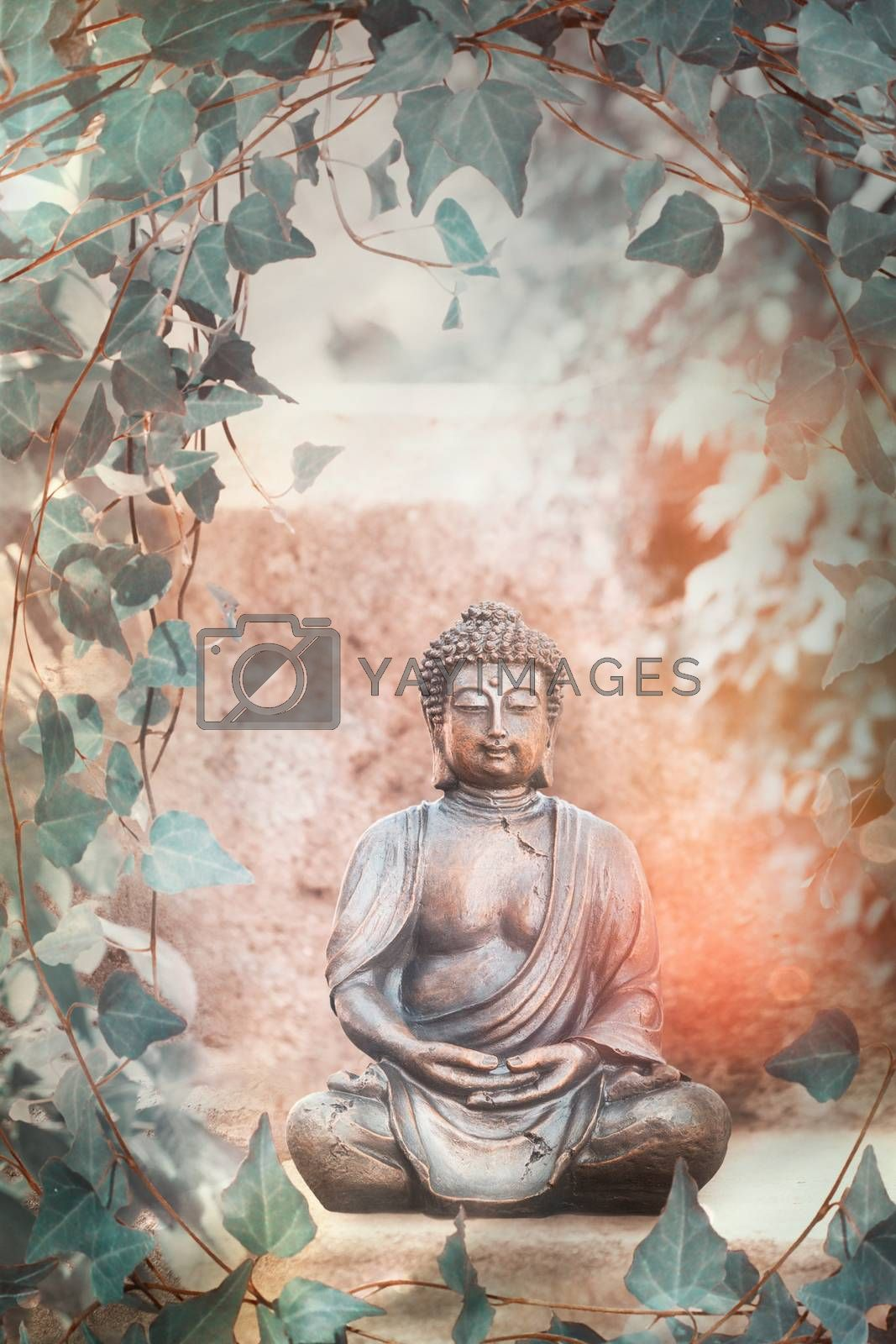 Buddha garden statue with vines and apple blossoms